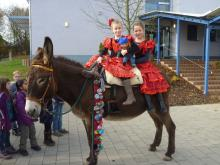 Two flamenco girls on a spanish donkey