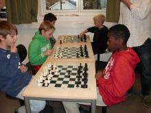 Some of the pupils in full action playing chess.